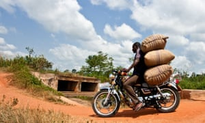 A man transports cocoa beans on a motor cycle in Abengourou, Ivory Coast.