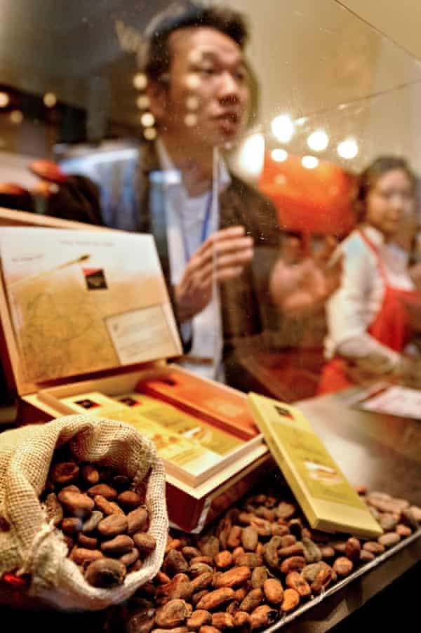 A man talks to visitors at a stall of the Salon du Chocolat in Shanghai.