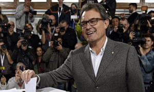President of Catalonia's regional government Artur Mas casting his ballot to vote in Barcelona on 9