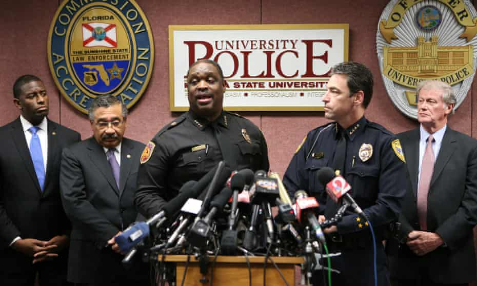 Florida State police chief, David Perry, center left, and Tallahassee police chief Michael DeLeo answer questions.