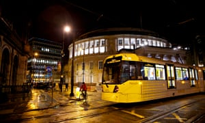 A Metrolink tram in St Peter's Square in Manchester