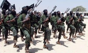 Al-Shabaab fighters perform military exercises.