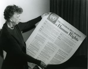 Eleanor Roosevelt, holding The Universal Declaration Of Human Rights in 1948, which she helped to draft.