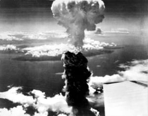 A mushroom cloud rises more than 60,000 feet into the air over Nagasaki