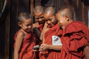 Young monks gathering around smartphone at bagan, Myanmar