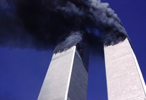 11 Sep 2001, New York, NY, USA --- Looking up from the location of Church and Fulton streets  both of the Twin Towers burn and exhaust large plumes of smoke approximately 25 minutes prior to the collapse of the South Tower