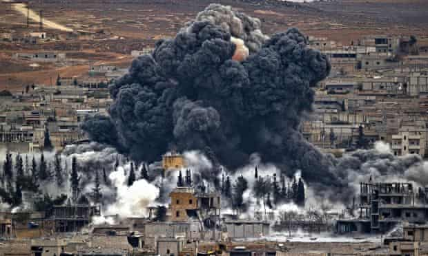 Smoke rises from the Syrian city of Kobani, following an air strike by the US led coalition