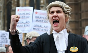 A barrister at a protest over cuts to legal aid, which has lost £350m a year – 83% of lawyers now be