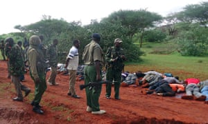 Security forces near victims killed in the dawn attack on a bus near Mandera, in which 28 non-Muslim