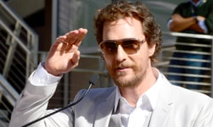 Matthew McConaughey salutes fans at the unveiling of his star on the Hollywood Walk of Fam, 17 November 2014.