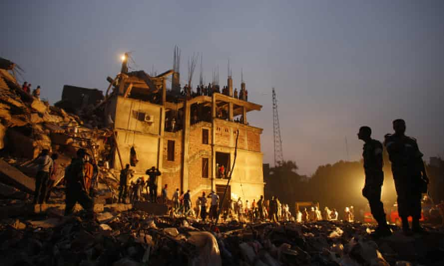 Rescue workers look for trapped garment workers in the collapsed Rana Plaza building in Savar, Bangladesh, in April 2013.