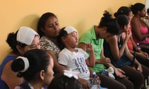People wait to be examined at a health centre in Villa San Francisco on the outskirts of Tegucigalpa October 2, 2014. Honduras' Minister of Social Development Lisandro Rosales said on Thursday there are already more than 400 people with possible symptoms of the painful mosquito-borne viral disease chikungunya in Villa San Francisco, and urged residents to stay inside the village, according to local media.