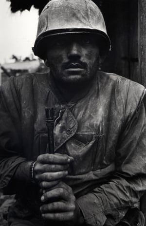 Shell-shocked US Marine, Vietnam, Hue, 1968. The Marine's fixed gaze, barely registering the presence of the camera, testifies to the traumatic experience of combat.