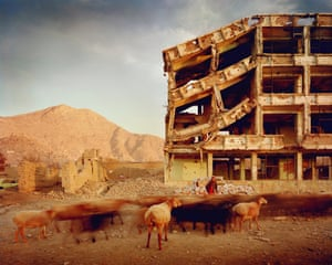 Bullet-scarred apartment building and shops in the Karte Char district of Kabul. This area saw fighting between Hikmetyar and Rabbani and then between Rabbani and the Hazaras.