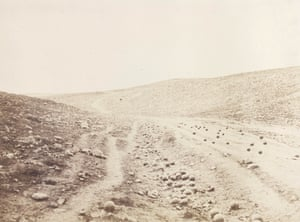 The Valley of the Shadow of Death, 1854.<br><br>During the Crimean war, Roger Fenton took two photographs of a ravine within range of the Russian fortifications at Sevastopol that was subject to intensive cannon-fire. Some scholars claim Fenton added the cannon balls in this photograph to increase the sense of danger. In the other photograph, the cannon balls are no longer on the track. Scholars suggest either that the road was cleared to allow for the passage of Fenton's mule-drawn dark room, or that the cannon balls were 'recycled' by nearby British soldiers to fire back at the Russian enemy.