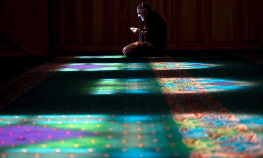 A Crimean Tatar prays at a mosque in Ukraine. The Russian annexation of Crimea has opened old wounds among the Tatars.