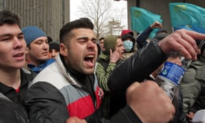 Crimean Tatar protesters during a demonstration near the Parliament building in Simferopol. Ukraine
