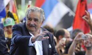 Newly sworn-in Uruguayan president Jose Mujica waves to crowd in the streets of Montevideo on  March 1, 2010.