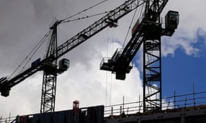 Cranes above a construction site in Manchester. The OECD says growth will coptinue in the UK through 2016.
