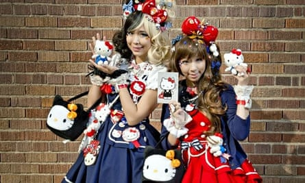Two girls adorned in Hello Kitty accessories