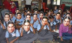 Pupils wear masks of Sachin Tendulkar at Puttamraju Kandrika village school in Nellore, Andhra Pradesh. He officially adopted the school.