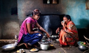 Lata cooking with her mother in the kitchen of her childhood home.