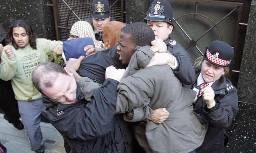 Michael Adebolajo (grey coat) during a riot outside Old Bailey, London, UK,  November 01, 2006.