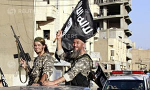 Islamic State (Isis) fighters parade through Raqq