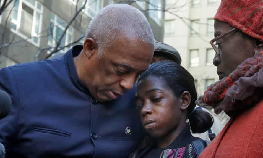 State Assemblyman-elect Charles Barron, left, and his wife city Inez Barron, flank Melissa Butler during a news conference outside the Brooklyn DA's office.