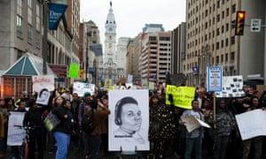 Demonstrators protest Tuesday, Nov. 25, 2014, in Philadelphia.