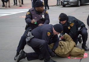 Cleveland police arrest a protester in Cleveland, Ohio during a demonstration in which they blocked the roads leading to Public Square November 25, 2014.