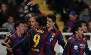 Barcelona's Lionel Messi celebrates with his team-mates after scoring his third goal against Apoel.