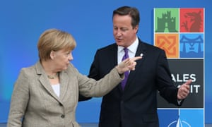 German Chancellor Angela Merkel gestures as she meets with British Prime Minister David Cameron at the NATO Summit on September 4, 2014 in Newport, Wales.