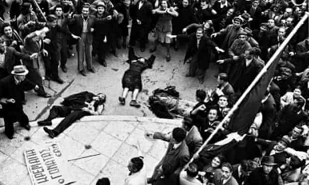 demonstrators in Athens with three bodies, shot dead, in the middle of the crowd