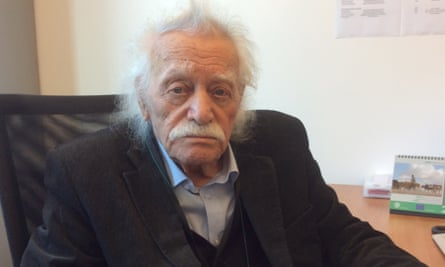 Manolis Glezos sitting at a desk