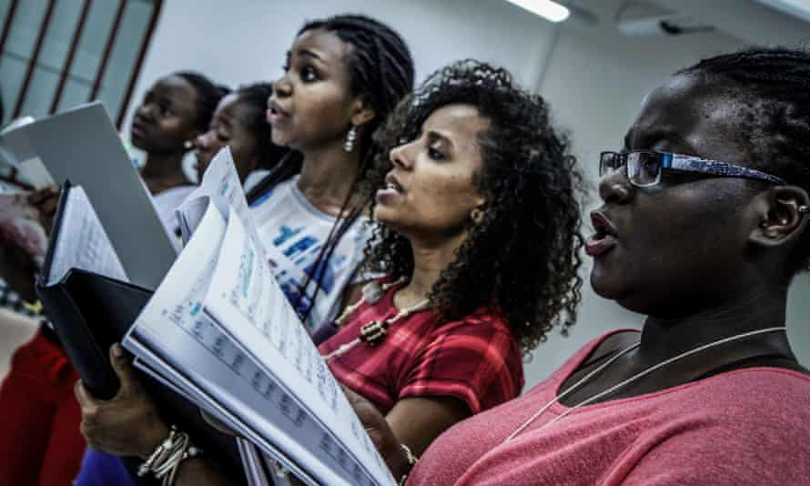 The choir in rehearsal for their new production.