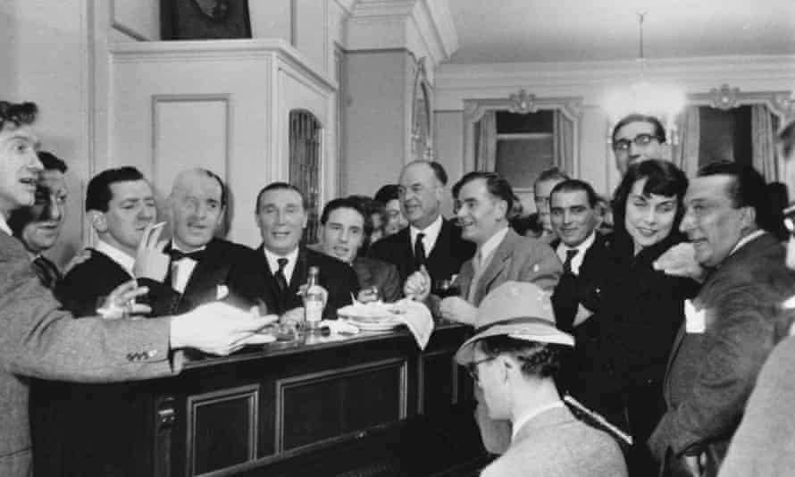 Frankie Fraser (fifth from left) among career criminals and journalists at a party in Soho.