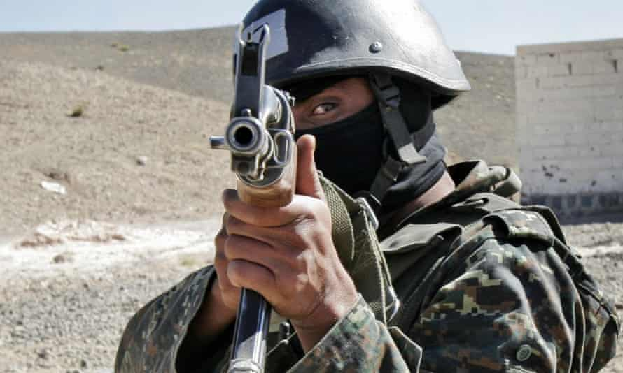 An anti-terrorist force member from the Ministry of Interior in training near San'a, in Yemen. Yemeni security forces were involved in raids on al-Qaida militants along with US special forces