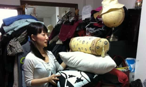 """Marie Kondo works at a client's home to clear away everything that is unneeded and fails to """"spark joy,"""" in Tokyo, Japan."""