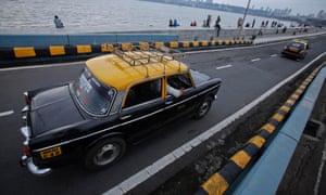 Local black-and-yellow taxis on Marine Drive, Mumbai.