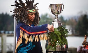 Alex Dan of the Musqueam first nation preforms a traditional blessing on the Grey Cup in Vancouver, British Columbia.
