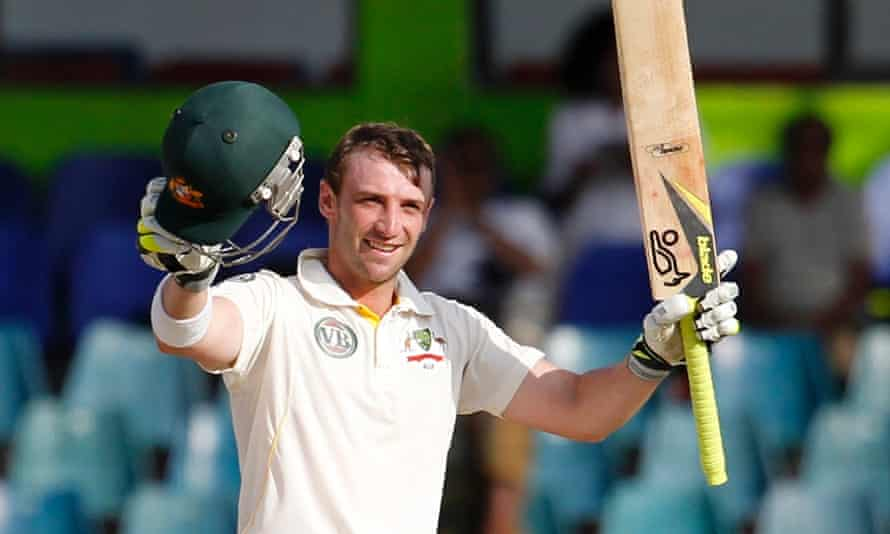 Phillip Hughes celebrates after scoring a century against Sri Lanka in Colombo.
