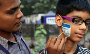 A young Mumbai City fan gets his face painted before the home game against Chennaiyin FC in the ISL.