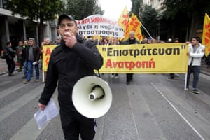 Protesters shout slogans as they march during a general strike in Athens, Greece, 27 November 2014.