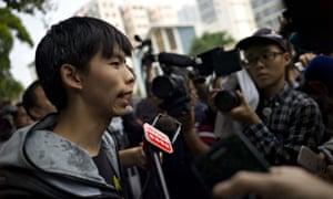 Student leader Joshua Wong (L) speaks wi