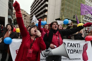Employees march  in central Athens during a protest rally marking a 24-hour general strike on November 27, 2014.
