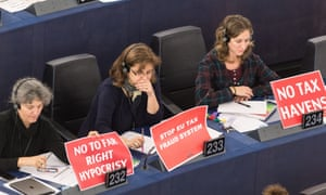 Members of far-left parties protest in the European parliament against the tax system in Luxembourg.