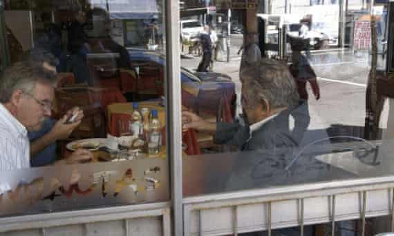 """Uruguay's President Jose """"Pepe"""" Mujica (on the right) at Bar Madison, Montevideo."""