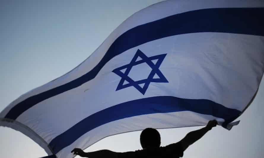 An Israeli waving the national flag