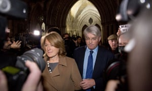 Andrew Mitchell and his wife Sharon walk away after the ruling was given in his case at the High Court